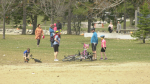 Small groups of people were gathered at Mooney's Bay Park on Sunday, April 11, 2021, but some residents reported much bigger gatherings the day before. Ontario is under a 28-day stay-at-home order. (Jackie Perez / CTV News Ottawa)