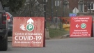 Signs directing drivers to parking at a COVID-19 assessment centre in Ottawa. (Colton Praill/CTV News Ottawa)