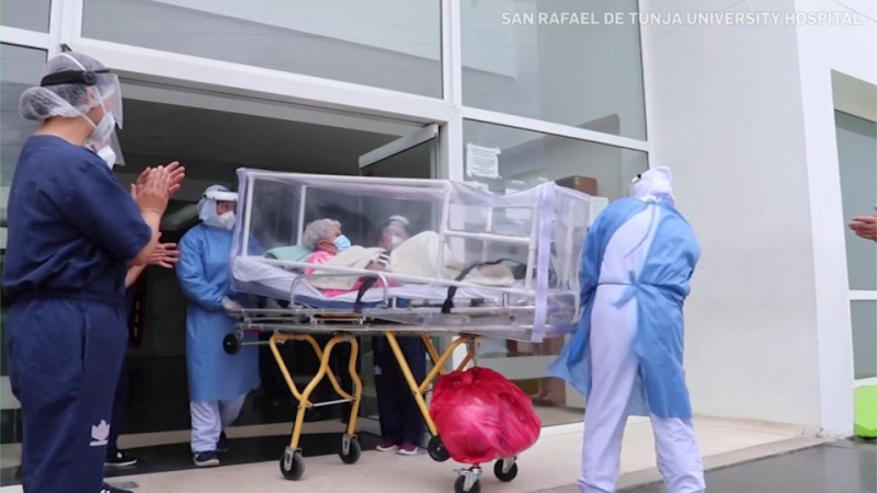 Doctors and nurses at San Rafael De Tunja University Hospital in northern Colombia are applauding Carmen Hernandez after she was discharged on April 5, 2021, following her recovery from the coronavirus for a second time. (Credit: San Rafael De Tunja University Hospital)