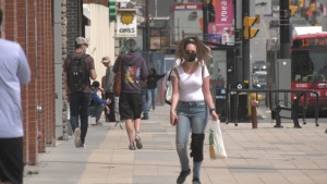 People walk down an Ottawa street during the COVID-19 pandemic. April 11, 2021. (Colton Praill / CTV News Ottawa)
