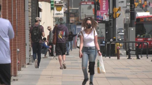 People walk down an Ottawa street during the COVID-19 pandemic. April 11, 2021. (Colton Praill / CTV News Ottawa)