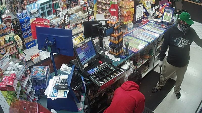 Surveillance footage shows a robbery by a man holding what appears to be holding a machete at a Circle K in Barrie, Ont. on Sun. April 11, 2021 (Supplied)