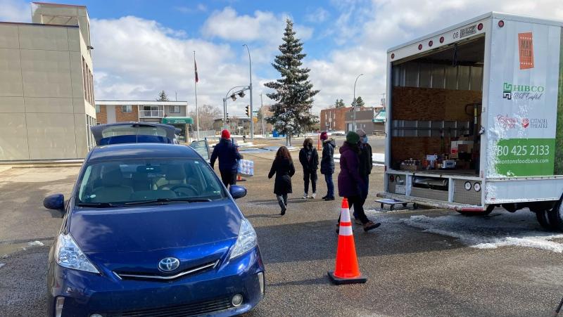 A car pulls up to the drive-thru food drive on Good Deeds Day in Edmonton (CTV News Edmonton/Brandon Lynch).