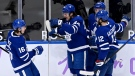 Toronto Maple Leafs centre Auston Matthews (34) celebrates his goal with teammates Mitchell Marner (16), Morgan Rielly (44) and Alex Galchenyuk (12) during first period NHL hockey action against the Ottawa Senators, in Toronto, Saturday, April 10, 2021. THE CANADIAN PRESS/Frank Gunn