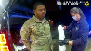 In this image made from Windsor, (Va.) Police video, Caron Nazario is helped by an EMT after he was sprayed with an agent by Windsor police after a traffic stop on Dec. 20, 2020, in Windsor, Va. (Windsor Police via AP)