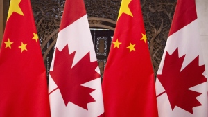 This Dec. 5, 2017, photo shows flags of Canada and China prior to a meeting of Canadian Prime Minister Justin Trudeau and Chinese President Xi Jinping at the Diaoyutai State Guesthouse in Beijing. THE CANADIAN PRESS/AP, Fred Dufour, Pool Photo