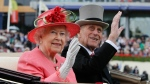 FILE - In this Thursday June, 16, 2011 file photo Britain's Queen Elizabeth II with Prince Philip arrive by horse drawn carriage in the parade ring on the third day, traditionally known as Ladies Day, of the Royal Ascot horse race meeting at Ascot, England. Buckingham Palace says Prince Philip, husband of Queen Elizabeth II, has died aged 99. (AP Photo/Alastair Grant, File)