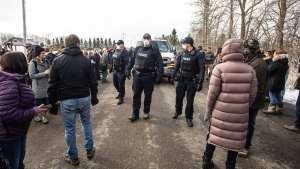 Police arrive as supporters gather outside GraceLife Church near Edmonton, Alta., on Sunday, April 11, 2021. The church has been fenced off by police and Alberta Health Services in violation of COVID-19 rules. THE CANADIAN PRESS/Jason Franson