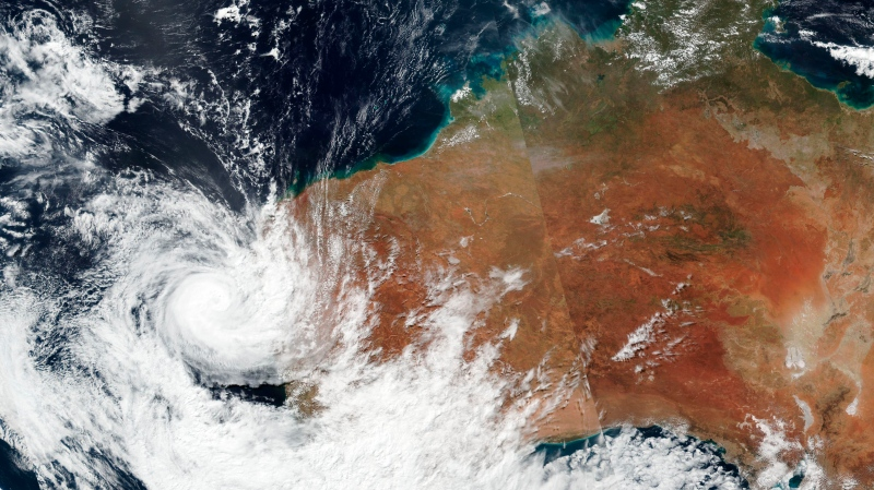 This Sunday, April, 11, 2021, satellite image released by NASA shows Tropical Cyclone Seroja hitting the coast of Western Australia. (NASA Worldview, Earth Observing System Data and Information System (EOSDIS) via AP)