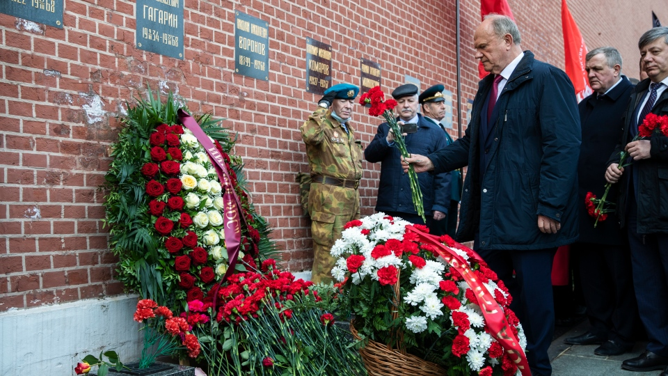 Russian Communist Party leader Gennady Zyuganov lays flowers at the grave of Yuri Gagarin, the first person who flew to space, in the Kremlin wall in Moscow, Russia, Monday, April 12, 2021. (AP Photo/Pavel Golovkin)