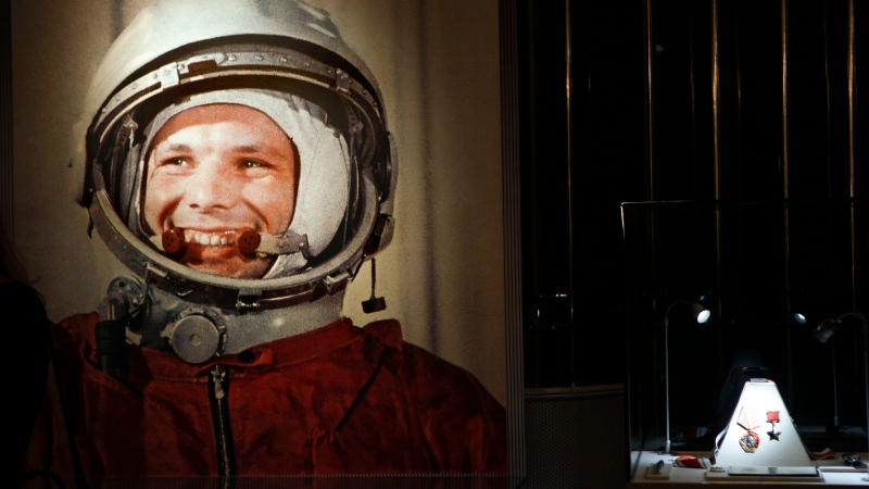 An undated portrait of the first man in space, Yuri Gagarin, and his award of the Hero of the Soviet Union, at right, part of an exhibition dedicated to the 50th anniversary of the first man in space, in Moscow, Russia. (AP Photo/Alexander Zemlianichenko, File)