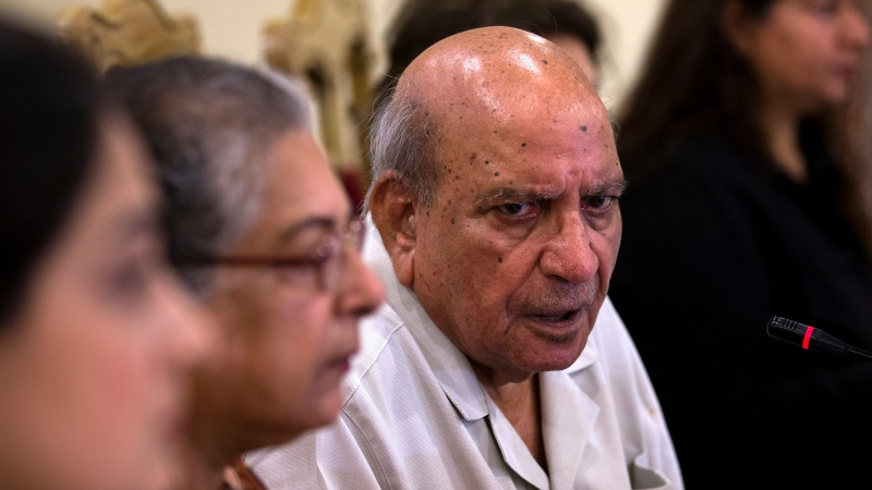 In this July 16, 2018 file photo, I.A. Rehman, center, an official from the Human Rights Commission addresses a news conference, in Islamabad, Pakistan. Rehman, an iconic Pakistani human rights defender and former editor, has died in the eastern city of Lahore after a brief illness his family said Monday, April 12, 2021. Rahman was 90. (AP Photo/B.K. Bangash, File)