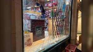 Rioters smashes several storefront windows in Old Montreal during a protest against the new 8 p.m. curfew imposed on the city Sunday, April 11, 2021. (CTV News)
