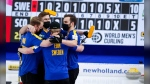 Sweden celebrates defeating Scotland in the Men's World Curling Championship gold medal final in Calgary, Alta., Sunday, April 11, 2021. (THE CANADIAN PRESS/Jeff McIntosh)