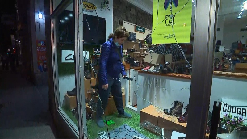 Stores vandalized after curfew protest
