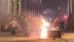 People take part in an anti-curfew protest in Montreal on Sunday April 11, 2021. THE CANADIAN PRESS/Giuseppe Valiante