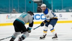 St. Louis Blues left wing Mike Hoffman (68) hits the puck over San Jose Sharks defenseman Marc-Edouard Vlasic (44) during the second period of an NHL hockey game in San Jose, Calif., Friday, March 19, 2021. (AP Photo/Tony Avelar)