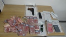 Thousands in counterfeit currency and weapons police seized while executing a warrant at an Orillia home on April 9, 2021