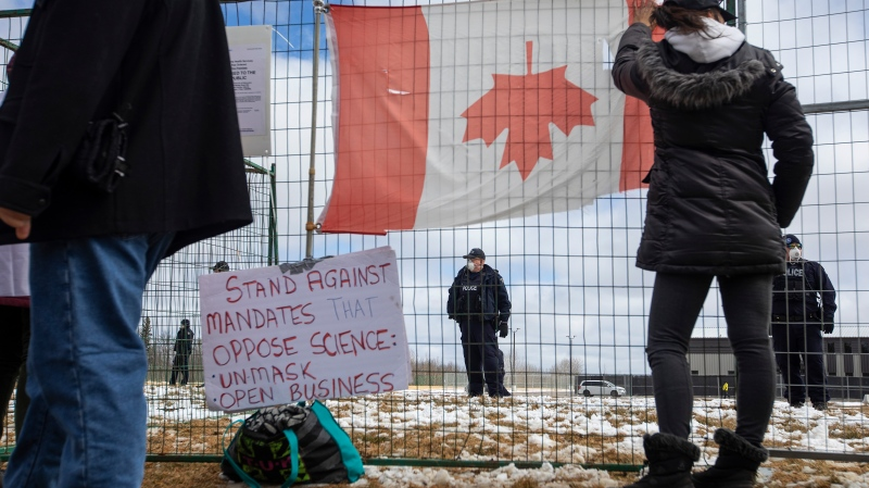 Supporters gather outside GraceLife Church near Edmonton, Alta., on Sunday, April 11, 2021. The church has been fenced off by police and Alberta Health Services in violation of COVID-19 rules. THE CANADIAN PRESS/Jason Franson