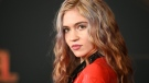 "Canadian musician Grimes, seen here in 2019, has unveiled the ""beautiful alien scars"" she's had tattooed across her entire back. Robyn Beck/AFP/Getty Images via CNN"