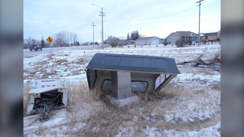 A truck cap is seen near a damaged traffic controller cabinet in the RM of St. Andrews on March 24, 2021. (Image source: Manitoba RCMP)