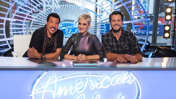 """ABC's """"American Idol"""" judge Luke Bryan, right, will sit out the program's first live show after testing positive for COVID-19. (Eric Liebowitz/ABC via Getty Images/CNN)"""