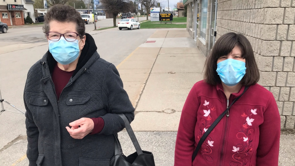 Shirley Cromwell of Glencoe, Ont., left, seen with her daughter Karen, is going to wait to get her COVID-19 vaccination at her community's pharmacy, Monday, April 12, 2021. (Sean Irvine /CTV News)