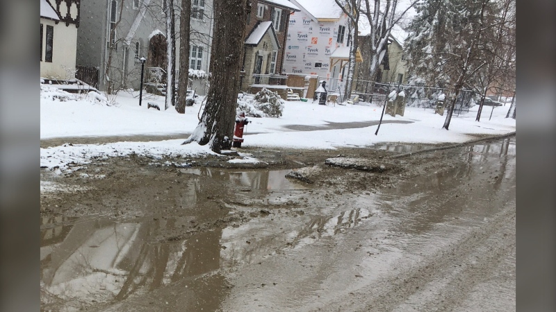 Crews work to repair a water main break on Elm Street between Grosvenor Avenue and Kingsway on April 12, 2021. (CTV News Photo Glenn Pismenny)