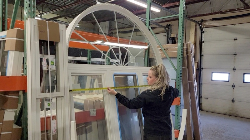 Connie Adams, regional operational manager for Brookstone Window and Doors, takes measurements in London, Ont. (Marek Sutherland / CTV News)