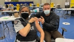 Sgt. Elenore Sturko with Surrey RCMP receives her first COVID-19 dose on April 12, 2021.