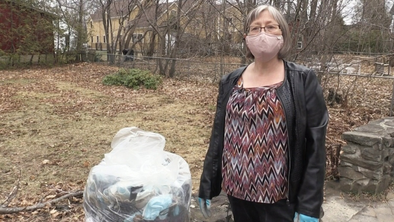 N.B. walker collects 100s of discarded masks