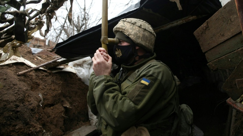 A Ukrainian soldier stands guard on the front line with Russia-backed separatists. (AFP)