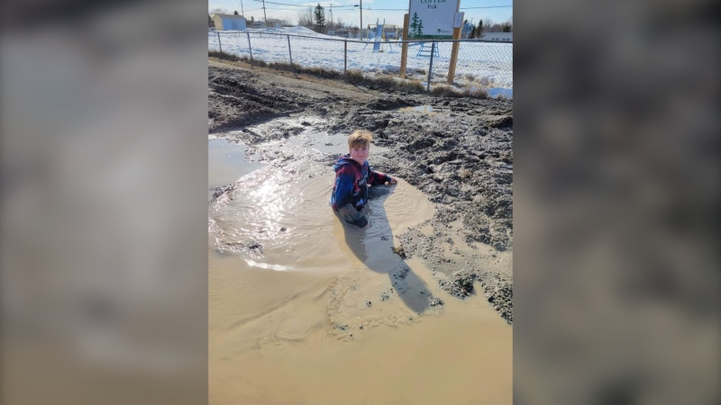 Samuel Desjardins got stuck in a hidden sinkhole Saturday afternoon in Thompson, Man. and emergency crews were called to get him out. (Source: Julie Desjardins/Facebook)