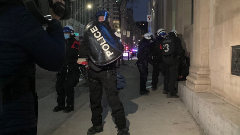 For the second night in a row, protesters were out in downtown Montreal on Mon., April 12, 2021, in violation of the city's 8 p.m. curfew. (Photo: CTV News/Angela Mackenzie)