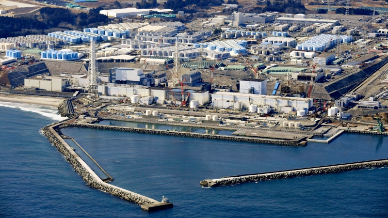 This Feb. 13, 2021, aerial photo shows Fukushima Daiichi nuclear power plant in Okuma town, Fukushima prefecture, north of Tokyo, Tuesday, April 13, 2021, Japan's government said Tuesday, April 13, 2021 it has decided to start releasing massive amounts of radioactive water stored in tanks at the wrecked Fukushima nuclear plant in two years after treatment. (Kyodo News via AP)
