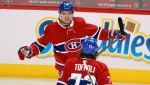 Montreal Canadiens' Nick Suzuki celebrates his goal against the Toronto Maple Leafs with teamed Tyler Toffoli during first period NHL hockey action in Montreal on Monday, April 12, 2021. THE CANADIAN PRESS/Paul Chiasson