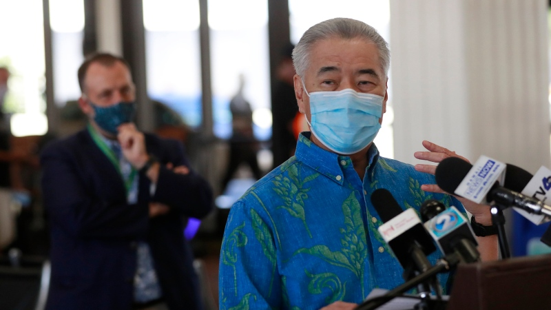 In this Oct. 15, 2020, file photo, Hawaii Gov. David Ige speaks at a news conference at the Daniel K. Inouye International Airport in Honolulu.  (AP Photo/Marco Garcia, File)