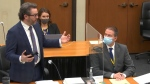 In this image from video, defence attorney Eric Nelson, left, discusses motions before the court as defendant, former Minneapolis police officer Derek Chauvin, right, and Nelson's assistant Amy Voss, back, listen, Monday, April 12, 2021, as Hennepin County Judge Peter Cahill presides over the trial of Chauvin at the Hennepin County Courthouse in Minneapolis. (Court TV, via AP, Pool)