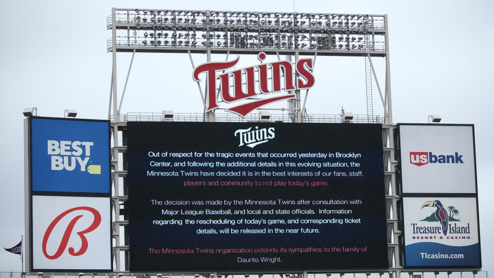 The scoreboard at Target Field explains the postponement of the baseball game between the Minnesota Twins and Boston Red Sox on Monday, April 12, 2021, in Minneapolis. (AP Photo/Stacy Bengs)