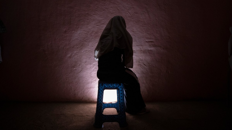 A Tigrayan refugee rape victim who fled the conflict in Ethiopia's Tigray sits for a portrait in eastern Sudan near the Sudan-Ethiopia border, on March 20, 2021. (Nariman El-Mofty / AP)