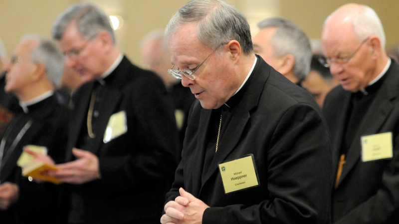 FILE - In this Monday, Nov. 10, 2008 file photo, Bishop Michael J. Hoeppner of Crookston, Minn. prays in Baltimore. The Vatican said Tuesday, April 13, 2021 that Pope Francis had accepted the resignation of Crookston Bishop Michael Hoeppner and named a temporary replacement to run the dioceses. (AP Photo/ Steve Ruark, File)