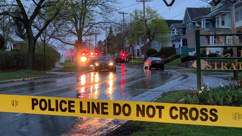 Police tape blocks off the scene an hour after a shooting on Grant Avenue in Syracuse, N.Y., on April 11, 2021. (Charlie Miller / The Post-Standard via AP)