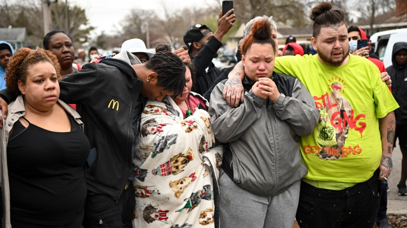 Family and friends of Daunte Wright, 20, grieve at 63rd Avenue North and Lee Avenue North hours after they say he was shot and killed by police, Sunday, April 11, 2021, in Brooklyn Center, Minn. Wright's mother, Katie Wright, stands at center. (Aaron Lavinsky/Star Tribune via AP)
