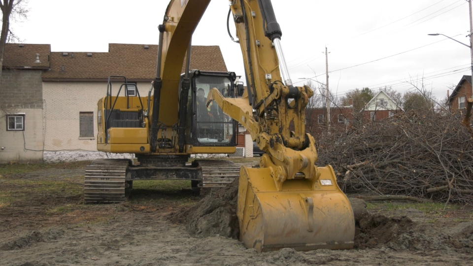 Excavator breaks ground on new transitional housin