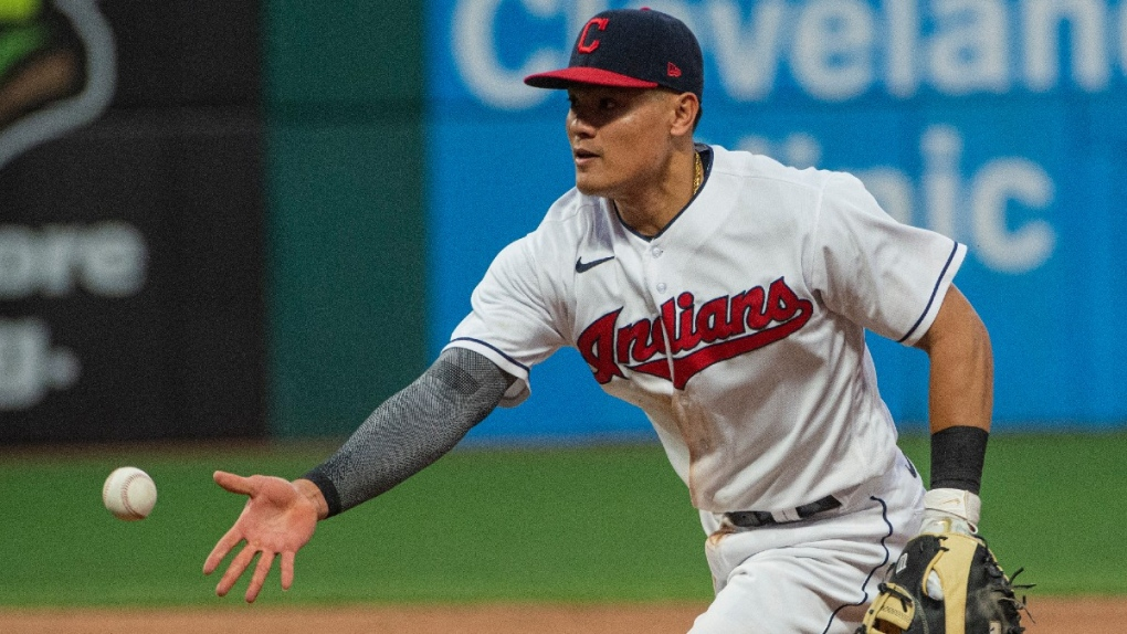 Cleveland Indians' Yu Chang tosses the ball
