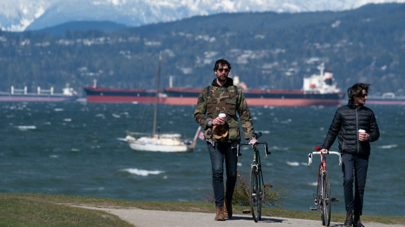 People enjoy the sunny but windy weather in Vancouver, B.C., Saturday, April 10, 2021. THE CANADIAN PRESS/Jonathan Hayward