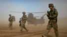In this Jan. 28, 2012 file photo, U.S. soldiers, part of the NATO- led International Security Assistance Force (ISAF) patrol west of Kabul, Afghanistan. (AP Photo/Hoshang Hashimi, File)