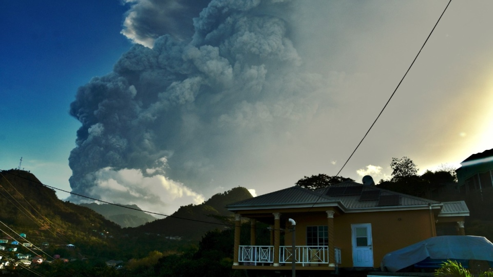 Ash rises into the air as La Soufriere volcano erupts on the Caribbean island of St. Vincent, on April 13, 2021. (Orvil Samuel / AP)