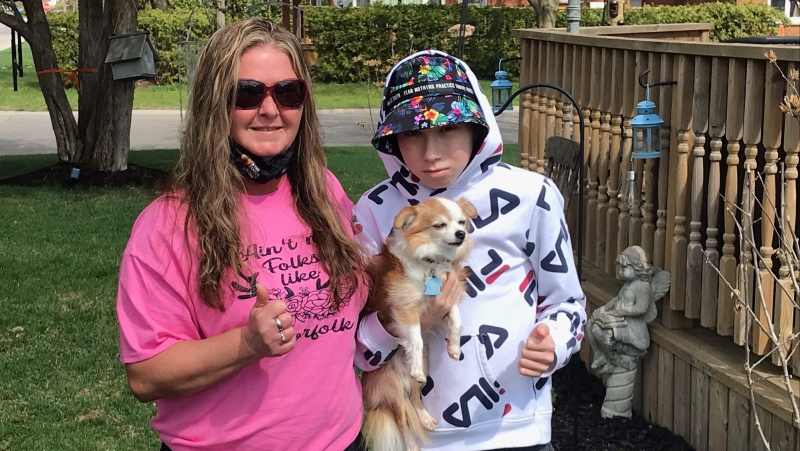 Bridgette Homenuik and her grandson, Ethan Shelly, are seen in Delhi, Ont. on April 13, 2021. Ethan is battling an aggressive cancer and Homenuik is coordinating and online birthday card campaign for Ethan's 14th birthday, May 13th. (Sean Irvine CTV News)