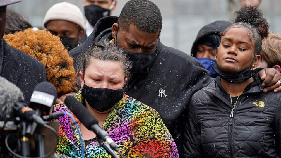 Katie Wright, left, the mother of Daunte Wright, and other family and friends gather during a news conference Tuesday, April 13, 2021, in Minneapolis as family attorney Ben Crump speaks. Daunte Wright, 20, was shot and killed by police Sunday after a traffic stop in Brooklyn Center, Minn. (AP Photo/Jim Mone)